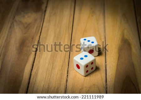 Casino dices on a vintage wooden - stock photo