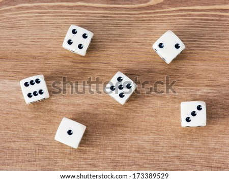Casino dices on a wooden table. Straight. - stock photo