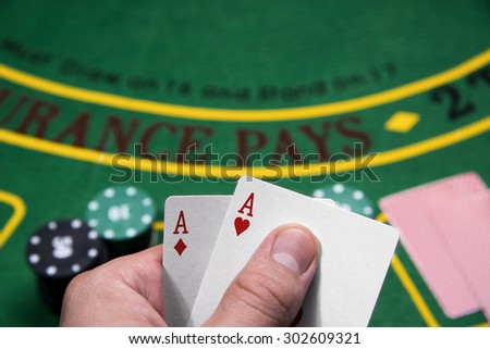 Casino, gambling, poker, people and entertainment concept - Two Aces playing - stock photo