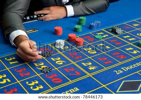 casino games with gambler hands - stock photo