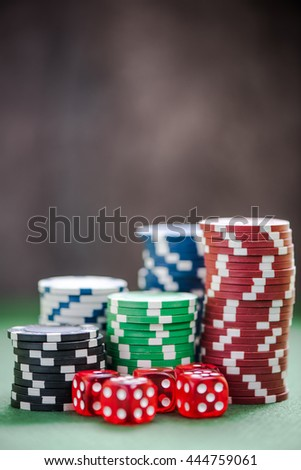 casino money chips and dices, poker play concept