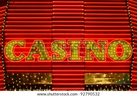 Casino neon side in a popular gambling area - stock photo