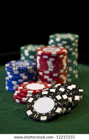 Casino poker gambling chips with copy space - stock photo
