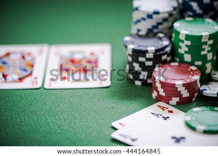 casino poker game with cards on green table