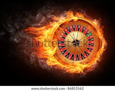 Casino Roulette in Fire Isolated on Black Background. - stock photo