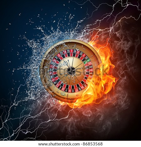 Casino Roulette in Water and Fire on Black Background. - stock photo