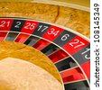 Casino roulette wheel close up. Gambling illustration concept. - stock photo