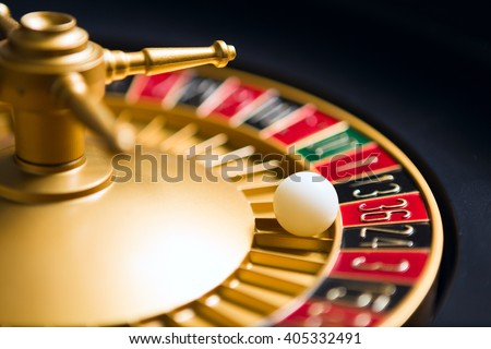 casino roulette wheel with the ball on number 36 - stock photo