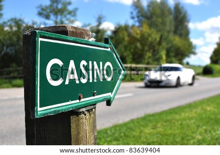 CASINO sign against sportive car on the rural road - stock photo