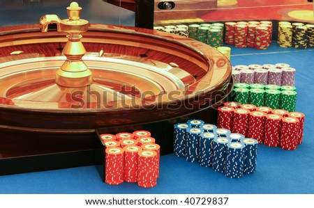 casino - spinning roulette wheel with ball, in expectation of good luck - stock photo