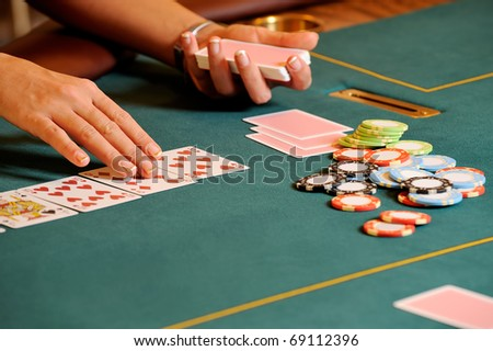 Casino table with hands - stock photo