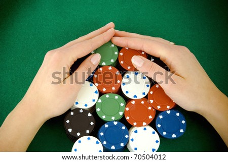 Casino win, gambling chips taken by hands - stock photo