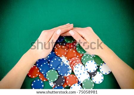 Casino win, gambling chips taken by hands - stock photo