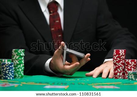 casino worker shuffling cards - stock photo