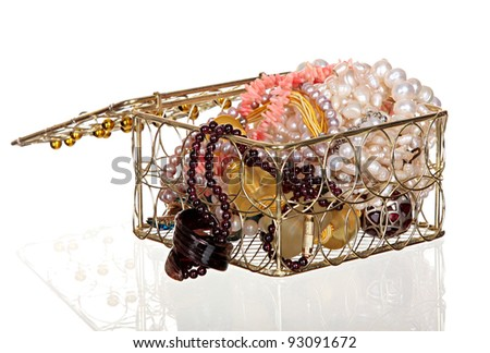 Casket from golden metal, with a beads and necklaces from natural pearls. - stock photo