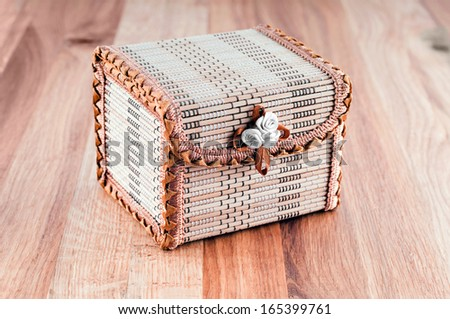 Casket on wooden background. - stock photo