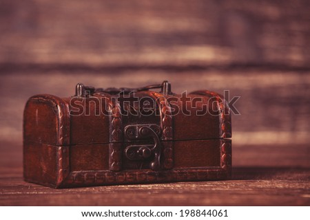 Casket on wooden table. - stock photo