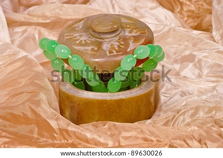 Casket with a beads on a fabric - stock photo