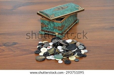 Casket with buttons - stock photo