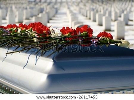 Casket  with flowers on top graveside at Arlington National Cemetery - stock photo