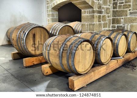 Casks in wine cellar - stock photo
