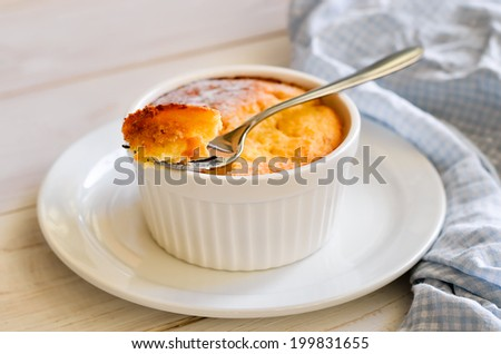 Casserole baked with cottage cheese, focus on piece pinned on a fork - stock photo