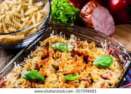 Casserole fusilli pasta with sausage, zucchini, paprika and cheese