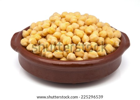 casserole of chickpeas cooked on a white background - stock photo