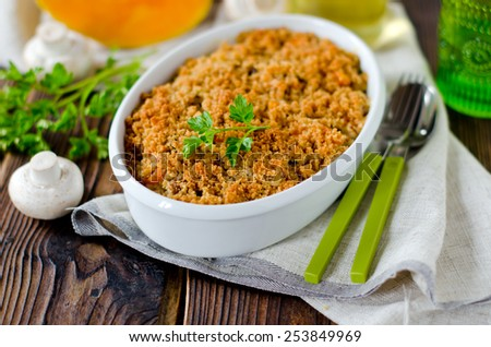 Casserole of rice, squash and mushrooms - stock photo