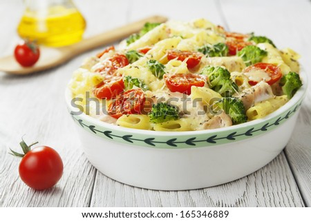 Casserole pasta with chicken and broccoli on the table - stock photo
