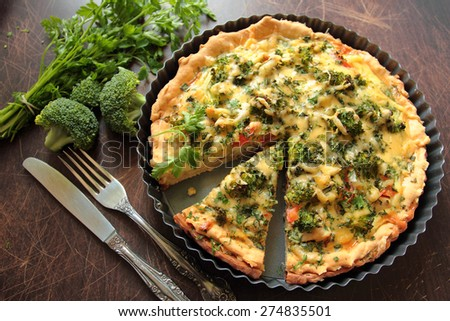 Casserole pie with vegetable, broccoli, cheese and fresh parsley - stock photo