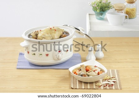 Casserole steaming pot for cooking variety food isolated in the kitchen interior
