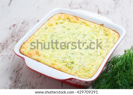 casserole  vegetables, cheese and zucchini,selective focus - stock photo