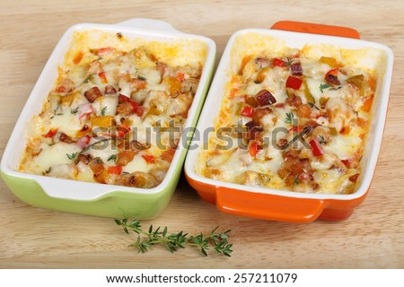 Casserole with bacon, cheese, pumpkin and pepper in baking dish.