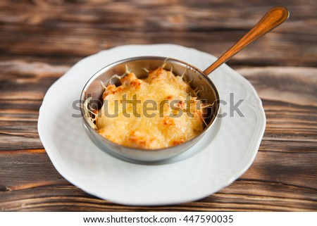 Casserole with chicken and mushrooms  julienne on the table. Horizontal top view     - stock photo