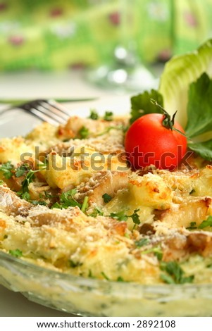 Casserole with fish and potatoes - stock photo