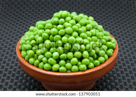 casserole with fresh green peas - stock photo