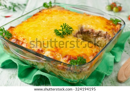 Casserole with pasta and minced meat under a cheese crust - stock photo