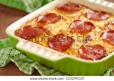 Casserole with pepperoni - stock photo