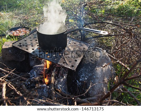 casserole with potatoes on the fire