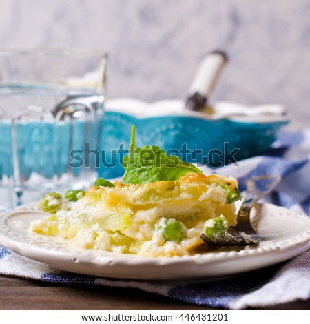 Casserole with zucchini and green peas. Selective focus. - stock photo