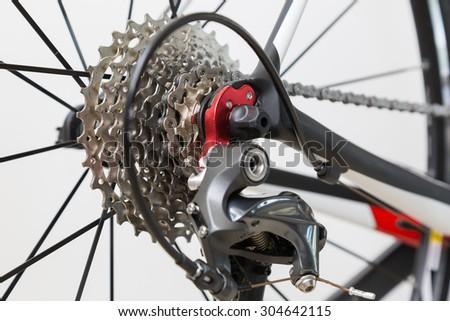 Cassette, derailleur and rear wheel of a modern, carbon racing bike. Shallow DOF. - stock photo