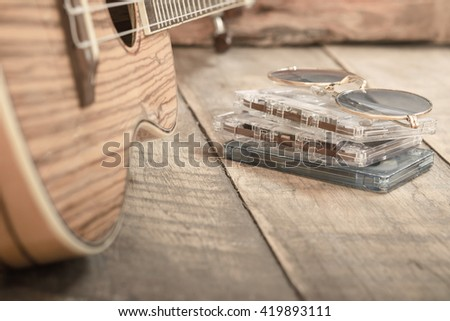 Cassette tape and guitar ,vintage background - stock photo