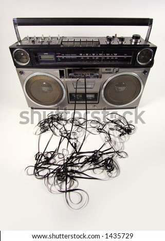 cassette tape spewing out of a retro ghettoblaster - stock photo
