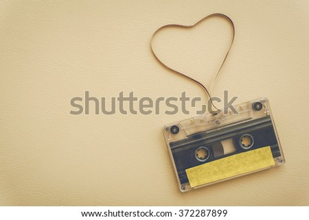 cassette tape with magnetic tape in shape of heart - vintage style