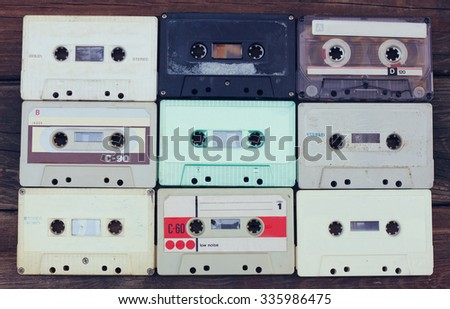 Cassette tapes over wooden table. top view.