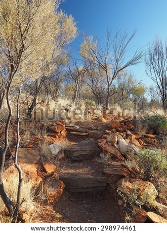 Cassia Hill hiking path in late afternoon near Simpsons Gap in the McDonnell Ranges, Alice Springs, Australia, June 2015
