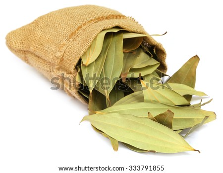 Cassia leaves in sack over white background