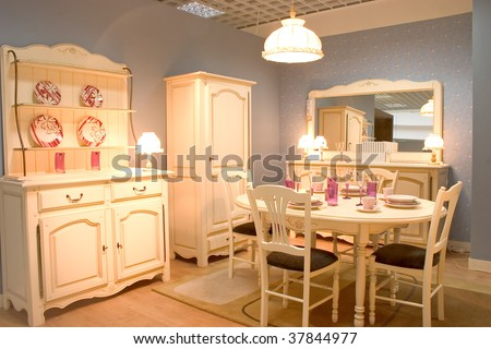 Cassic dining room with wooden furniture and warm white tones. - stock photo