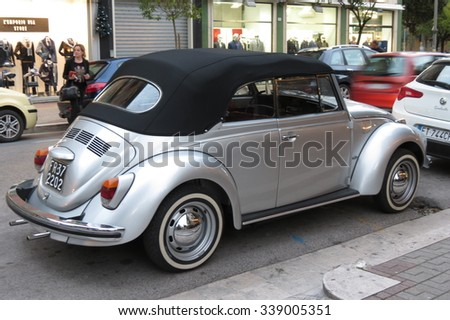 CASSINO, ITALY - CIRCA OCTOBER 2015: Metallic grey Volkswagen Beetle cabriolet vintage car parked in a street of the city centre.  - stock photo